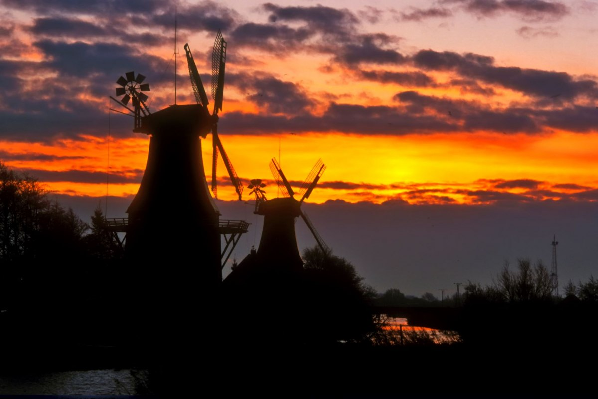 The twin mills of Greetsiel on the old Greetsieler Sieltief are a landmark of the popular place on the North Sea coast
