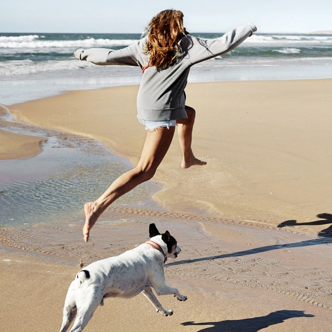 Woman with dog on the beach campaign 2020