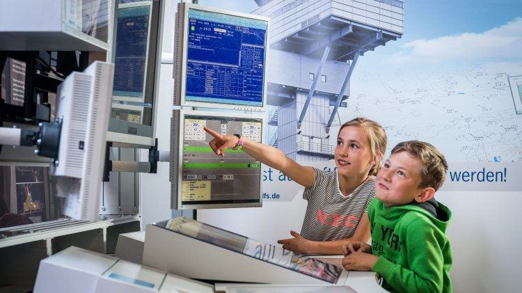 children next to the air traffic control